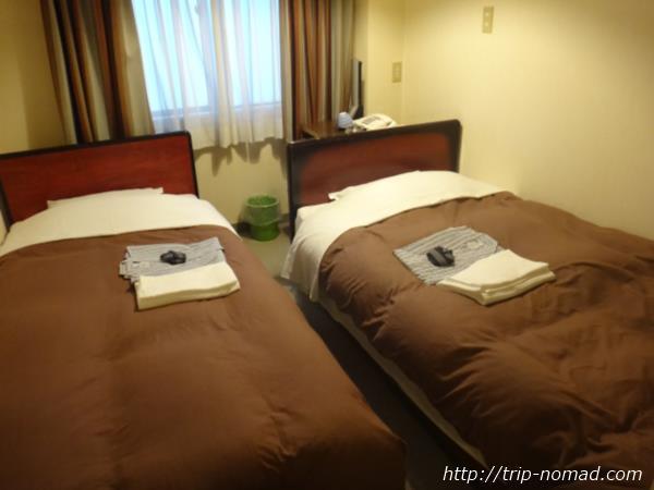 『ホテルニュームラコシ』室内ベッド